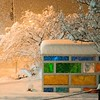 ADAM SHANKS — THE BERKSHIRE EAGLE The colorful bus stop on Main Street in North Adams is blanketed in more than a foot of snow on Wednesday night, March 7, 2018.