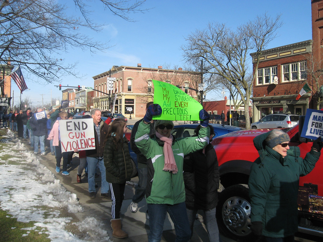 BOB SANDRICK / GAZETTE Demonstrators favoring stricter gun regulations march around Public Square on Saturday morning in Medina. They were taking part in the March for Our Lives campaign occurring throughout the nation.