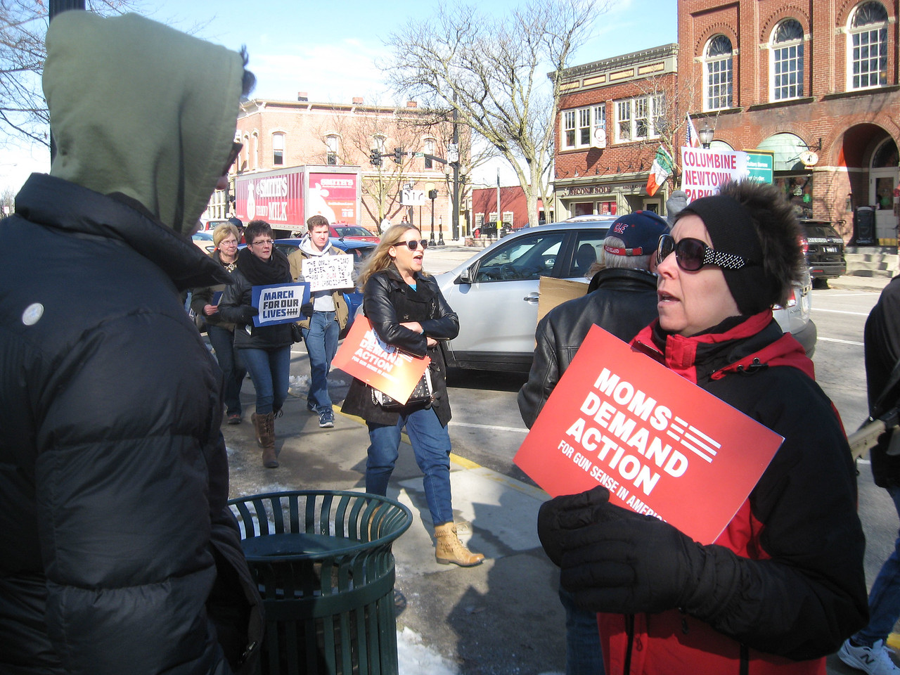 BOB SANDRICK / GAZETTE  Jackie Thompson, right, of North Royalton, a pro-gun-control demonstrator, has a civil debate with an anonymous Second Amendment counter-demonstrator Saturday during the March for Our Lives rally on Public Square in Medina.