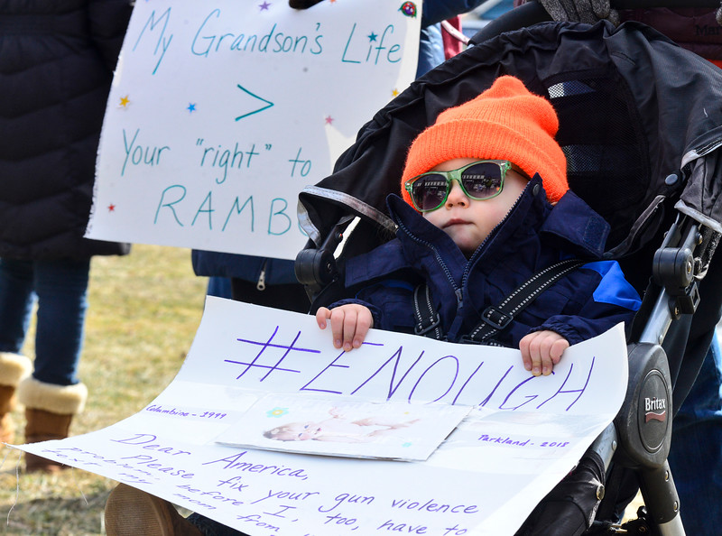 KRISTOPHER RADDER - BRATTLEBORO REFORMER<br /> Callum Parnell, 1, of Springfield, Vt., holds a sign during the March for our Lives Rally in Putney, Vt., on Saturday, March 24, 2018.