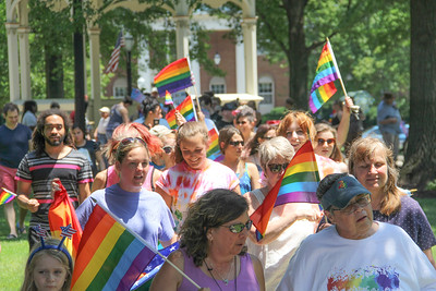 ALEC SMITH / GAZETTE About 100 people march around Public Square in Medina on Sunday afternoon at a rally held by the nonprofit group OutSupport, which advocates for equal rights for lesbian, gay, bisexual and transgender individuals.