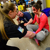 KRISTOPHER RADDER - BRATTLEBORO REFORMER<br /> Lt. Emily Stone, of Rescue Inc. checks over Sage Hall, a senior at Leland & Gray Union Middle and High School, while she talks about prom during a school bus crash mass casualty drill on Wednesday, May 16, 2018.
