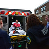 KRISTOPHER RADDER - BRATTLEBORO REFORMER<br /> Sage Hall, a senior at Leland & Gray Union Middle and High School, is loaded into an ambulance during a school bus crash mass casualty drill on Wednesday, May 16, 2018.