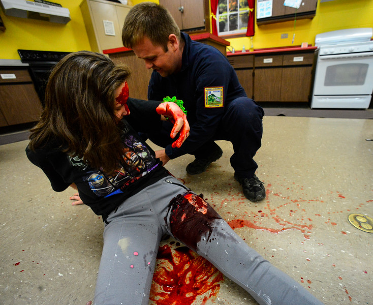 "KRISTOPHER RADDER - BRATTLEBORO REFORMER<br /> Rescue Inc. Operations Chief Drew Hazelton setups up the scene as a ""bus"" pins Nastia Stevens, a senior at Leland & Gray Union Middle and High School,  during a school bus crash mass casualty drill on Wednesday, May 16, 2018."