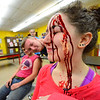 KRISTOPHER RADDER - BRATTLEBORO REFORMER<br /> Fellow volunteers look on as Sage Hall, a senior at Leland & Gray Union Middle and High School, gets covered in fake blood.