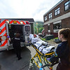 KRISTOPHER RADDER - BRATTLEBORO REFORMER<br /> Nastia Stevens, a senior at Leland & Gray Union Middle and High School, is loaded into an ambulance during a school bus crash mass casualty drill on Wednesday, May 16, 2018.