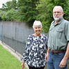 Newly-appointed Hoosic River Revival Executive Director Matthew Miller and the organization's founder, Judith Grinnell, standing in front of the flood chutes that control the southern branch of the Hoosic River. With Miller's hiring, Grinnell is reducing her role within the nonprofit but will remain involved in its work. Thursday, July 6, 2017. Adam Shanks — The Berkshire Eagle