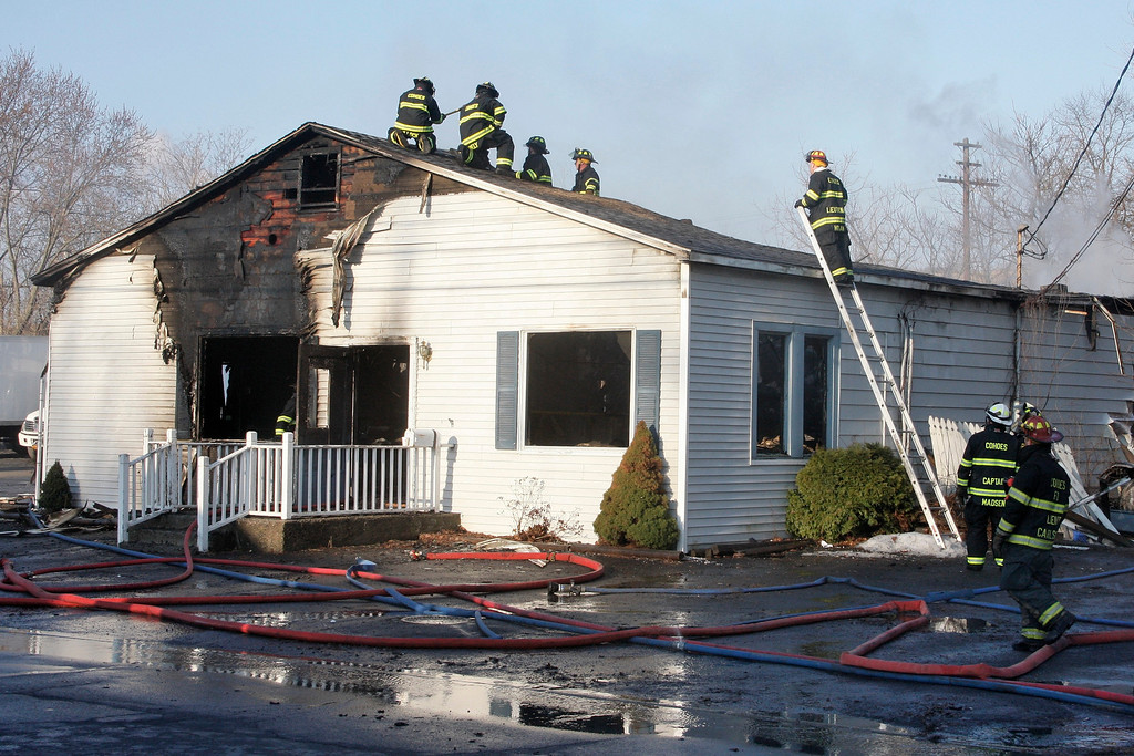 . A early morning fire destroyed Matt\'s Fish Fry & Seafood Mart at 574 Saratoga St in Cohoes, Wednesday April 9, 2014. (Mike McMahon - The Record)