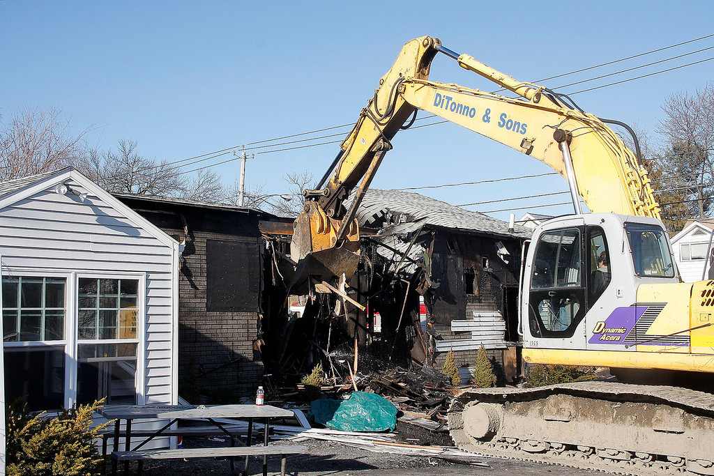 . Mike McMahon - The Record, Matt\'s Fish Fry was demolished by DiTonno & Sons  after a early morning fire Wednesday morning, Tuesday March 30, 2014