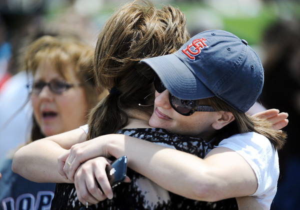 Globe/T. Rob Brown<br /> Klista Reynolds (right), Joplin R8 School District technology coordinator, and Shelly Tarter, Joplin R8 teacher, comfort each other during an announcement on the future of the district Monday afternoon, May 30, 2011, outside the tornado-stricken Joplin High School.