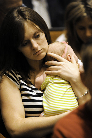 Globe/T. Rob Brown<br /> Torrie Epperson, of Joplin, holds close her 5-week-old baby, Alice Epperson, as she waits for President Barack Obama and Missouri Gov. Jay Nixon to take the stage Sunday afternoon, May 29, 2011, at Missouri Southern State University's Taylor Performing Arts Center. Epperson, who is a Joplin High School teacher, said she and her baby were home alone when last Sunday's tornado destroyed their home.