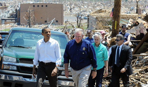 Globe/T. Rob Brown<br /> President Barack Obama and Missouri Gov. Jay Nixon tour the damage created by last Sunday's tornado, Sunday afternoon, May 29, 2011, near Joplin High School.