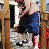 "Globe/T. Rob Brown<br /> Robert Stewart comforts his 8-year-old son Decosh Stewart, who suffers from autism, as another storm front moves into the area Friday afternoon, May 27, 2011, outside the ruins of their 2105 Pennsylvania Ave. home in Joplin. Stewart's wife said, ""We were home when it happened and Decosh was at a neighbor friend's house. We hid in the basement and Robert ran to our son as soon as the storm passed."""