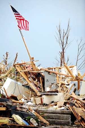 Globe/T. Rob Brown<br /> A home near Joplin High School shows its former occupant's patriotism Friday morning, May 27, 2011.