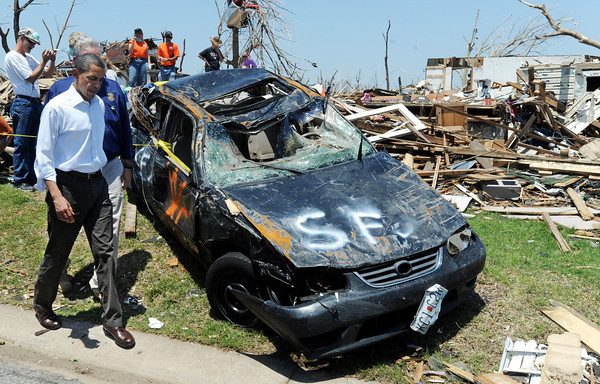Globe/T. Rob Brown<br /> President Barack Obama tours an area damaged by last Sunday's tornado, Sunday afternoon, May 29, 2011, near Joplin High School.