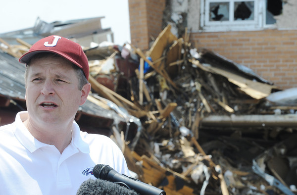 Globe/T. Rob Brown<br /> Joplin R8 School District Superintendent C.J. Huff speaks Monday afternoon, May 30, 2011, outside the tornado-stricken Joplin High School.