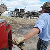 Globe/T. Rob Brown<br /> Steve Baker, co-owner of Baker's Towing Service, operates a wench in an attempt to turn over a 9-ton propane truck that was thrown across a lot by Sunday's tornado, on Thursday afternoon, May 26, 2011, in order to salvage what they can.