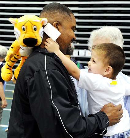 Globe/T. Rob Brown<br /> New MU head basketball coach Frank Haith shares a laugh with 2-year-old Alikai Haidle, of Joplin, whose home was destroyed Sunday, during a visit to the Missouri Southern State University shelter in the Leggett & Platt Athletic Center. Haith and assistants brought in stuffed tigers to give to children and others in need of comfort.