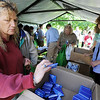 Globe/T. Rob Brown<br /> Kathy Robbins (left), of Charlottesville, Ind., grabs some insect repellant/sunscreen combo packets for family who were victims of Sunday's tornado on Thursday afternoon, May 26, 2011, outside Missouri Southern State University's Taylor Performing Arts Center. Robbins said her family member's home was gone. Lynn Cole (right), Missouri Department of Health & Senior Services, of Jefferson City, assists those in need.