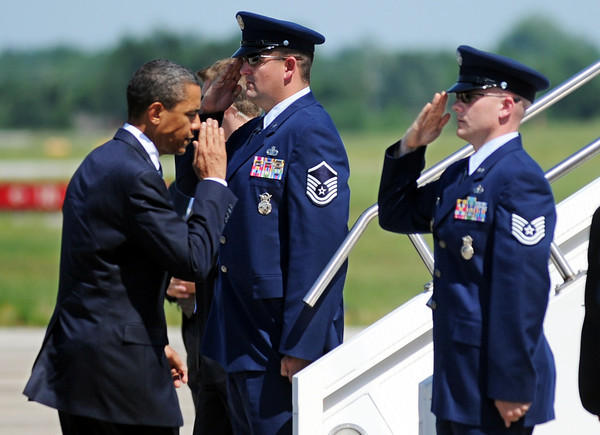 Globe/T. Rob Brown<br /> President Barack Obama salutes his airplane's pilots as they salute him and he boards Sunday afternoon, May 29, 2011, at Joplin Regional Airport.