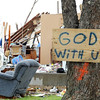 Globe/T. Rob Brown<br /> A sign outside a home, a few blocks from Joplin High School, shows that faith is not gone for the home's former occupants Friday morning, May 27, 2011.