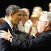 Globe/T. Rob Brown<br /> President Barack Obama shakes hands with the Father who survived the tornado during a memorial service Sunday afternoon, May 29, 2011, at Missouri Southern State University's Taylor Performing Arts Center.