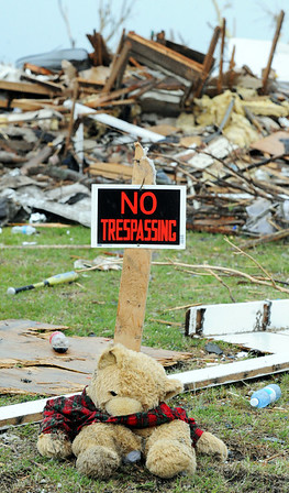 "Globe/T. Rob Brown<br /> A ""No Trespassing"" sign and a Teddy bear warn off looters from the remains of a tornado victim's home Friday afternoon, May 27, 2011, on Missouri Avenue, near Joplin High School."