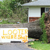 Globe/T. Rob Brown<br /> A sign warns looters to beware Wednesday afternoon, May 25, 2011, on East 20th Street in Duquesne.