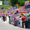 Globe/T. Rob Brown<br /> Locals hold up U.S. flags as President Barack Obama's motorcade Sunday afternoon, May 29, 2011, on approach to MSSU.
