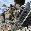 Globe/T. Rob Brown<br /> Steve Baker, co-owner of Baker's Towing Service, hooks up a 9-ton propane truck that was thrown across a lot by Sunday's tornado, as he works to turn it over Thursday afternoon, May 26, 2011, in order to salvage what they can.