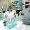 Globe/Roger Nomer<br /> Sandra McMahan, Neosho, and Jeanann Grundy, Carthage, look at a pottery piece on Thursday at Phoenix Fired Arts.