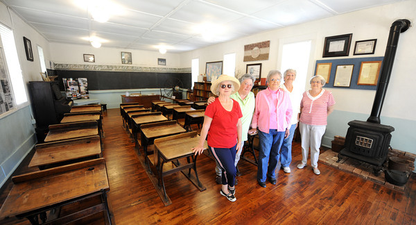 Globe/T. Rob Brown<br /> Cave Springs School's, from left, Wanda Tackett, of Stott City, Helen Hunter, of Carthage, Pat Beasley, of Carl Junction, Jan Whitworth, of Joplin, and Betty Still, of Carthage, stand inside the school Thursday morning, May 10, 2012, where most of them attended. Beasley, Whitworth, Hunter and Still are all sisters who grew up in the Cave Springs area, just north of Sarcoxie. The historic school was in operation from 1838-1966 and was restored in 2007. It also served as a Civil War Union militia headquarters and as the Jasper County Courthouse from 1865-1866.