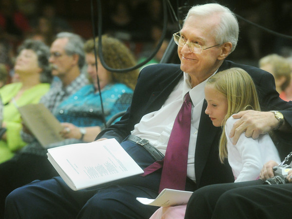 "Globe/Roger Nomer<br /> Hubert Bird embraces his granddaughter Hannah Arvidsson, 8, while listening to his composed piece ""The Other Side of Storm"" at Memorial Hall on Saturday evening."