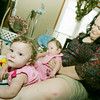 Globe/Roger Nomer<br /> Jayme Harper plays with Addison, left, and Lauren on the triplets birthday on Thursday.