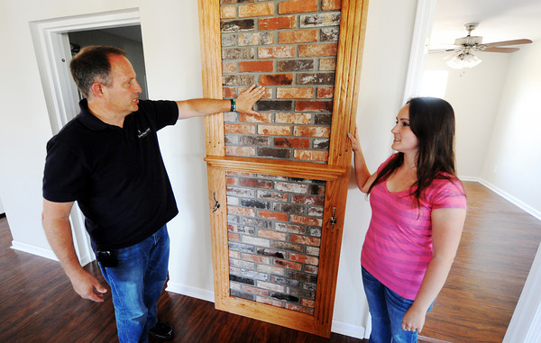Globe/T. Rob Brown<br /> Misty Gamble, right, and Samaritan's Purse volunteer coordinator and case manager Stephen Bergen, of Carthage, stand next to a portion of her home memorializing the hearth from her father's home Wednesday afternoon, May 16, 2012.