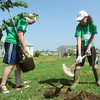 Globe/Roger Nomer<br /> Suzie Phelps, left, and Brittany Bowman, freshmen at the Nineth Grade Center in Troy, plant a tree at the corner of 22nd and Delaware during the Root for Joplin event on Saturday.