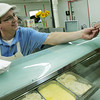 Globe/Roger Nomer<br /> Billy Garrigan offers a sample of lemon ice cream to a customer at Anderson's Ice Cream and Cinnamon Rolls.