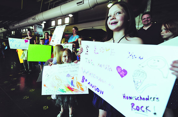 Globe/T. Rob Brown<br /> Sisters Peyton, 2, left, and Chaselyn Evans, 7, both of Reeds Spring, greet top-10 finalists from American Idol with signs Monday afternoon, May 7, 2012, at the Branson Airport.