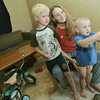 Globe/Roger Nomer<br /> Heather Gifford plays a game with her sons Tommy Morris, 5, and Eric Gifford, 2, at their FEMA trailer on Wednesday morning.  Gifford has been trying to move her family out of the FEMA trailer, but so far hasn't been able to find housing.