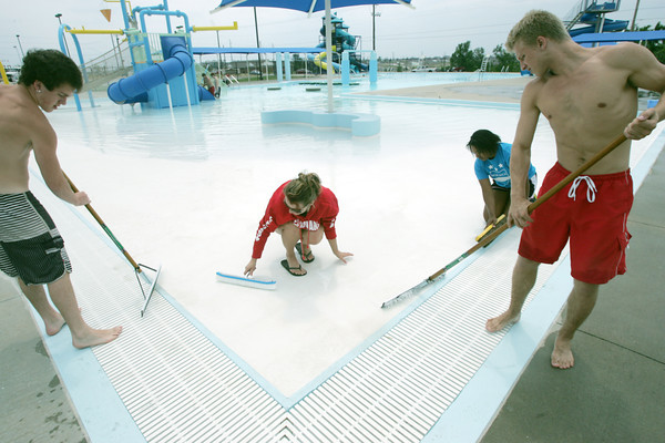 Globe/Roger Nomer<br /> (from left) Lifeguards Austin Ritter, Brittany Larery, Danielle Walker and Joshua Bogatay clean Cunningham Pool in preparation for its opening this holiday weekend.