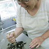 Globe/Roger Nomer<br /> Patty Galbraith chops up Oreo cookies with a masher used in the original Anderson's.