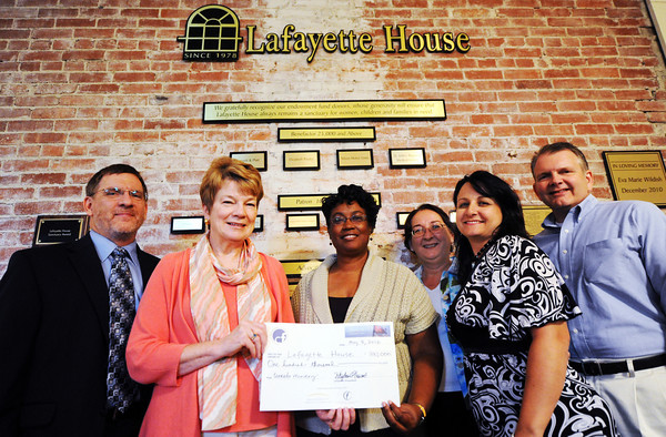 Globe/T. Rob Brown<br /> Community Foundation of Southwest Missouri donates $100,000 to Lafayette House Tuesday morning, May 8, 2012. Pictured from left: Brad Baker, Lafayette House treasurer, Barbara Hicklin, incoming Lafayette House president, Michelle Ducre, regional development director for the foundation, Alison Malinowski Sunday, lafayette House executive director, Stephanie Howard, foundation chair, and Dale Harrington, Lafayette House board member.