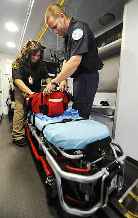 Globe/T. Rob Brown<br /> Alexis Jeffers, EMT, left, and Adam Clifton, EMT student, check their gear inside a Joplin's METS ambulance Thursday afternoon, May 10, 2012, to make sure it's ready to go when needed. The ambulance service was part of the EF-5 Tornado Disaster Medical Strike Team on May 22, 2011.