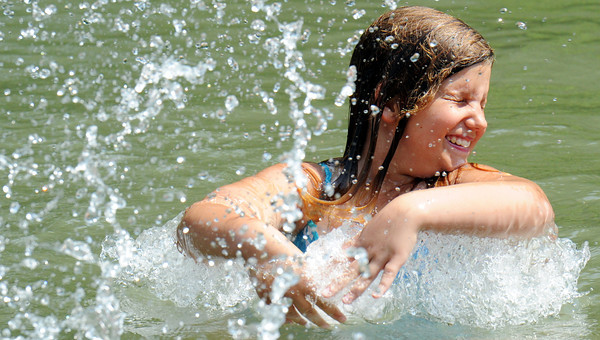 Globe/T. Rob Brown<br /> Hailey Gordon, 10, of Carl Junction, reacts to being splashed by a family member during a splashing contest Friday afternoon, May 25, 2012, at the Stone's Corner Public Fishing Access, Missouri Conservation Department, on North Main Street/43 Highway, for Center Creek.