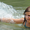Globe/T. Rob Brown<br /> Hailey Gordon, 10, of Carl Junction, starts to splash a family member Friday afternoon, May 25, 2012, at the Stone's Corner Public Fishing Access, Missouri Conservation Department, on North Main Street/43 Highway, for Center Creek.