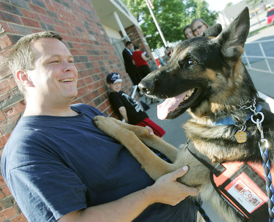 Globe/Roger Nomer<br /> Scott Yates and Havoc, from Paws K-9 Search and Rescue, attend the unveiling of the service dog stamp at the Carl Junction Post Office on Wednesday.