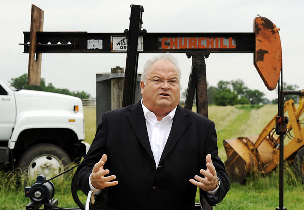 Globe/T. Rob Brown<br /> Congressman Billy Long speaks about domestic oil in front of an oil pump on a property 14 miles west of Girard, Kan., Thursday afternoon, May 24, 2012.