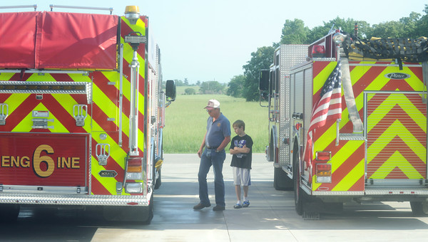 Globe/Roger Nomer<br /> Joe and his nephew AJ, 11, Lair check out the engines at Fire Station #6 on Saturday morning.