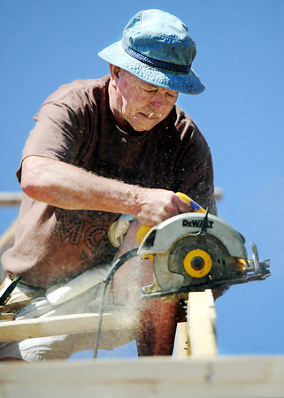 Globe/T. Rob Brown<br /> Bill Aber, of Jefferson City, a volunteer with Community Christian Church of Jefferson City, works on the roof of a house Monday afternoon, May 21, 2012, in the 2600 block of West 32nd Street in Joplin. The home was severely damaged during the May 22, 2011, tornado and is being repaired by the combined efforts of Americorps and a group of Christian churches.