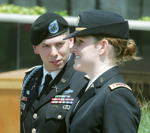 Globe/Roger Nomer<br /> 1st Lt. Tyson Patrick congratulates his wife 2nd Lt. Rachel Patrick after she took her oath at a Memorial Day ceremony at the Pittsburg State University Veterans Memorial in Pittsburg, Kan., on Monday, May 28, 2012.